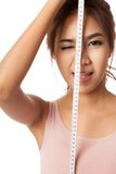 Asian slim girl wink her eye with measuring tape Royalty Free Stock Images