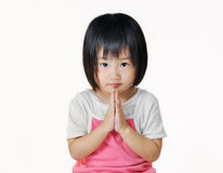 Asian small child pay respect in Thai style. Asian small child pay respect by pressing the hands together at the chest on white background Stock Photography