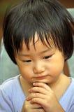 Asian small girl feel bored Stock Image