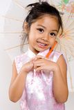 Asian smile. Asian girl smiling holding traditional umbrella Stock Photography