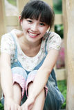 Asian smile girl. Happy Asian girl relaxing outdoor Royalty Free Stock Photo