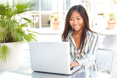 Asian smile and laptop. Beautiful asian girl working on her laptop, businesswoman or student Stock Photography