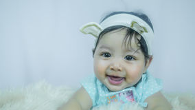 Asian Smiling baby girl Royalty Free Stock Images