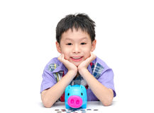 Asian smiling boy with piggy bank Stock Photos