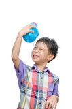 Asian smiling boy with piggy bank Stock Images