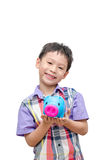 Asian smiling boy with piggy bank Royalty Free Stock Image