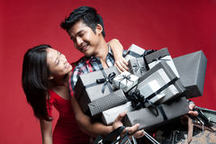 Asian Smiling Couple with presents Royalty Free Stock Photos