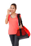 Asian Smiling fit young woman with gym bag standing ready for fitness exercise. Stock Image