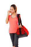 Asian Smiling fit young woman with gym bag standing ready for fitness exercise. Royalty Free Stock Photo