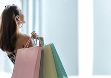 Asian smiling lifestyle woman so happy shopping in casual clothing with shopping bags in the model tower shopping mall. stock image