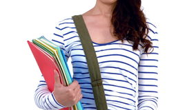 Asian smiling student holding books stock footage
