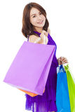 Asian smiling young woman holding shopping bag Royalty Free Stock Image