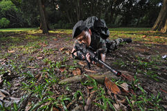 Asian Sniper taking an aim Stock Images