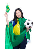 Asian soccer fans draped with Brazil flag Royalty Free Stock Photo