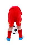 Asian soccer player holding his soccer ball, studio shot. Isolat Stock Photo