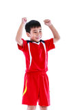 Asian soccer player showing arm up gesture. Action of winner or Stock Photo