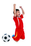 Asian soccer player showing arm up gesture. Action of winner or Stock Photos