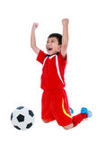 Asian soccer player showing arm up gesture. Action of winner or Royalty Free Stock Photography