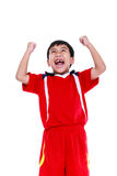 Asian soccer player showing arm up gesture. Action of winner or. View from below of happy young asian soccer player in red uniform  screaming and showing arm up Stock Images