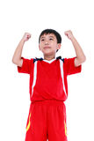 Asian soccer player showing arm up gesture. Action of winner or Royalty Free Stock Photo