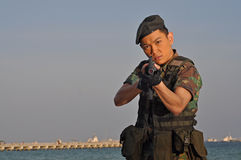 Asian Soldier pointing the rifle at viewer stock images
