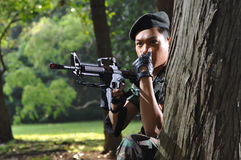 Asian Soldier signaling for an attack stock photography