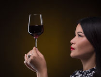 Asian sommelier woman with glass of red wine Stock Image