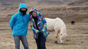 Asian son and mother taking family trip to Iceland. Taking photo Stock Images