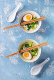 Asian soup with eggs, onion and spinach Royalty Free Stock Photos
