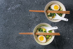 Asian soup with eggs, onion and spinach Stock Images