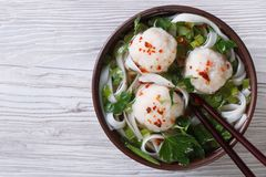 Asian soup with fish balls and rice noodles top view Royalty Free Stock Photography
