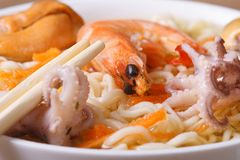 Asian soup with seafood and noodles close up. Horizontal Stock Photo