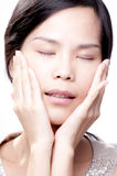 Asian Spa Beauty. Young asian female with her hands on face in beauty shot Stock Image