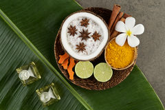 Asian spa setting with coconut, turmeric, lime, cinnamon, anise Stock Photo