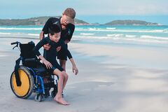 Free Asian Special Child On Wheelchair Playing Doing Activity Vacation On Sea Beach In Summer Royalty Free Stock Photography - 209119107