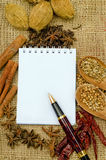 Asian spice and notepad. On a burlap canvas Stock Photo