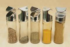 Asian spices. Five asian spices in glass bottles Stock Photo