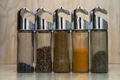 Asian spices. Five asian spices in glass bottles Stock Image