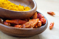 Asian spices, dried red chili and curcuma in wooden bowls Royalty Free Stock Photo