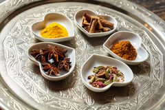 Asian spices in heart shaped dishes over plate Stock Photos