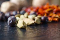 Asian Spices piled on slate Stock Photo