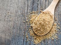 Asian spices. Svan salt in spoon on wooden background. Closeup royalty free stock photos