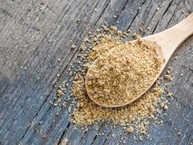 Asian spices. Svan salt in spoon on wooden background. Closeup royalty free stock photography