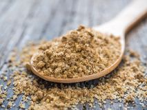Asian spices. Svan salt in spoon on wooden background. Closeup.  stock photo