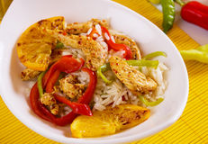 Asian spicy chicken with rice. Asian spicy chicken meat with cooked rice and orange Royalty Free Stock Images