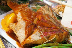 Asian Spicy Fish. Asian style deep fried pomfret with sweet spicy sauce Royalty Free Stock Photography