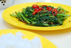 Asian spicy vegetables. Asian Kangkong vegetables cooked with spicy sambal chili sauce. Also known as Ipomoea Aquatica or water spinach. Suitable for food and Stock Photo