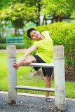 Asian Sport Boy Stretching On Iron Bar In Garden Royalty Free Stock Photo