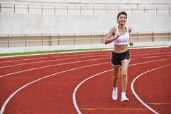 Asian sport girl exercising. Royalty Free Stock Photo