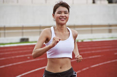 Asian sport girl exercising. Royalty Free Stock Photos